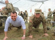 Secretary of the Army Eric Fanning and Pvt. 1st Class Jacob Hauser earned their cake doing push-ups. Hauser starred in two of the #EarnYourCake clips that sparked Fannings impromptu visit to LSA Warhammer, June 14. (Photo Credit: 1st Lt. Hilary Klotz, 16th Sustainment Brigade Public Affairs Officer)