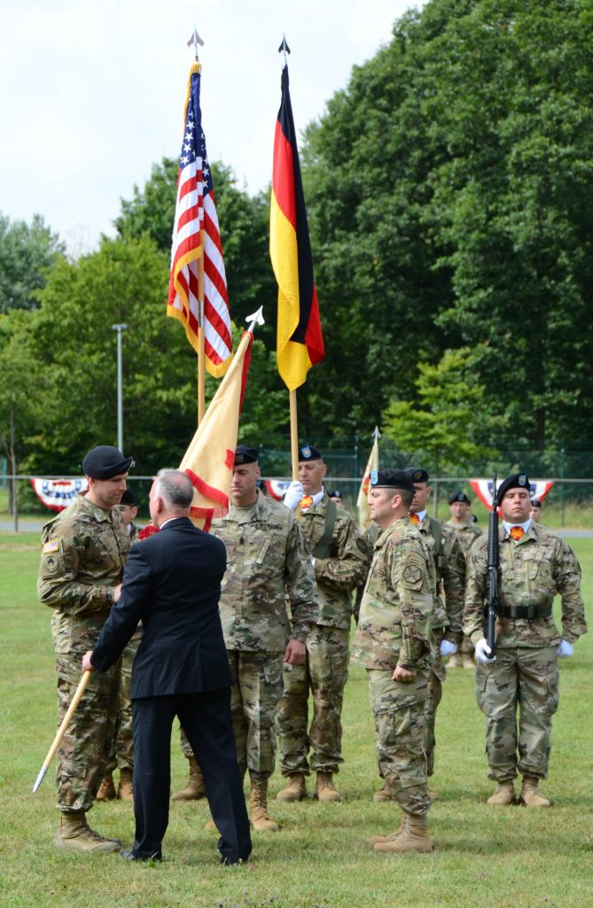 ANSBACH, Germany (July 18, 2016) -- Michael D. Formica, director of Installation Management Command - Europe, passes the U.S. Army Garrison Ansbach guidon to Col. Benjamin C. Jones, left, signifying Jones's assumption of command of the Ansbach garrison. (U.S. Army photo by Stephen Baack, USAG Ansbach Public Affairs)