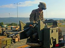 Spc. Jonathan Cyr, Anvil Company, 1st Combined Arms Battalion, 64th Armor Regiment mounts a 50 caliber machine gun onto a M1A2 Abrams tank, July 21, 2016 before heading out to the field for training.