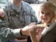 In this Army file photo, a Soldier takes her daughter out the car. (U.S. Army News Service)