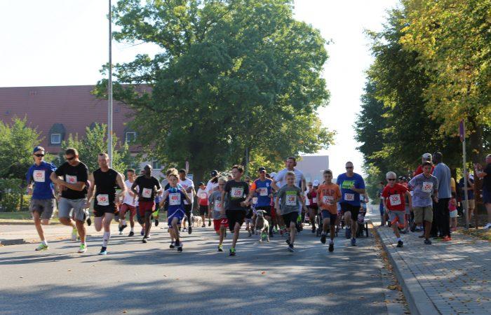 U.S. Army Garrison Ansbach community members begin the five-kilometer Back-to-School Fun Run.