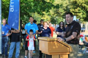 Col. Benjamin C. Jones speaks before the Back-to-School Fun Run.