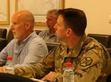 Col. Benjamin C. Jones, right, U.S. Army Garrison Ansbach commander, and Stephen Povilaitis, left, Installation Management Command ADVON team leader at Mihail Kogâlniceanu Air Base, Romania, listen to a briefing on the transfer of base operations from USAREUR to IMCOM during Jones' first visit to the site, which is overseen by USAG Ansbach.