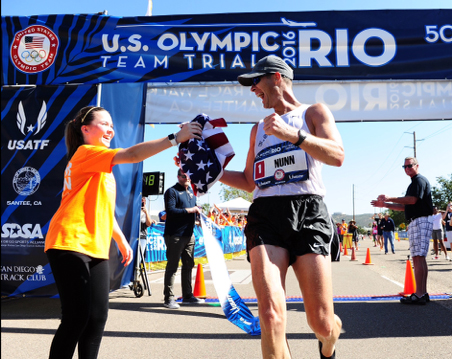 U.S. Army World Class Athlete Program race walker Staff Sgt. John Nunn receives an American flag from his daughter Ella after winning the 2016 U.S. Olympic Team Trials for the 50-kilometer race walk February 21, 2016, in Santee, California. Nunn won the event with a personal-best time of 4 hours, 3 minutes, 21 seconds on the 31-mile course to earn his third Olympic berth. (Photo Credit: Courtesy photo)