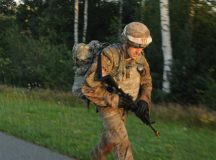"Staff Sergeant Ethan Rodgers of 7th Army Training Center, Europe's 2016 ""Best NCO Warrior,"" completes a grueling 12-mile foot march Aug. 11 during 2016 USAREUR Best Warrior Competition held at the Grafenwoehr Training Area. The Blaine, Tennessee native triumphed in the NCO category over eight other command-level victors. He'll represent USAREUR during the Army-wide BWC slated for Sept. 26-Oct. 3 at Fort A.P. Hill in Virginia. (U.S. Army Photo by Staff Sgt. Frank Brown Jr., 18th Military Police Brigade Public Affairs)"