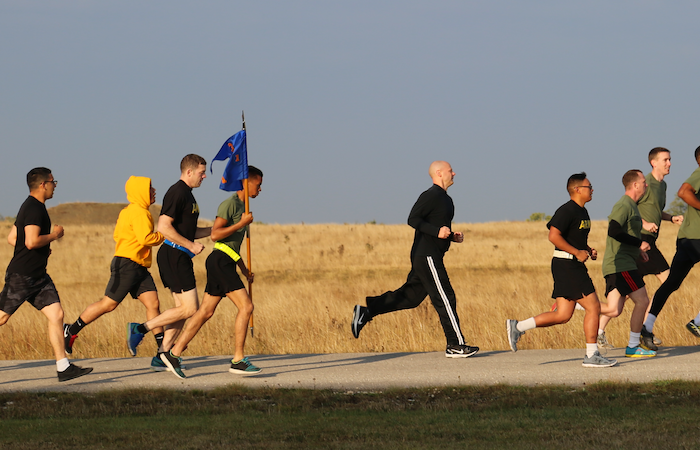 USAG Ansbach community members run through a field in Urlas Community to bring awareness to suicide prevention efforts.