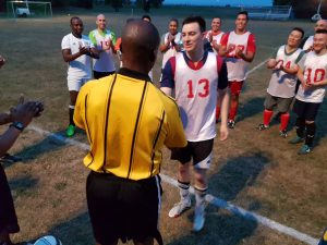 Teammates applaud Pfc. Tyler Kennington for earning most valuable player.