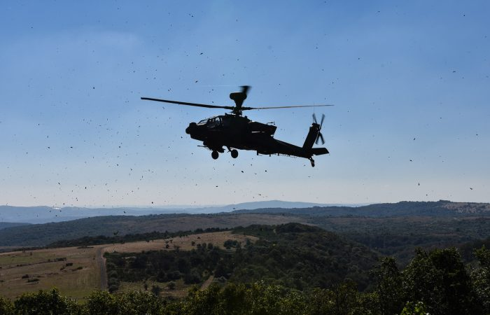 An AH-64 Apache Helicopter from C Company, 1st Battalion, 3rd Aviation Regiment, 12th Combat Aviation Brigade, conducts a show of force over an observation point on the range during Griffin Strike 2016, Sept. 7, near Baumholder, Germany. Griffin Strike is a 10-day multi-national exercise aimed at training joint fires support teams in the coordination and control of artillery, fixed wing close air support and rotary wing assets. (Photo Credit: Capt. Jaymon Bell, 12th Combat Aviation Brigade)