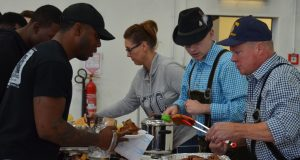 Volunteers from the U.S. Army Garrison Ansbach community lade out traditional German fest foods to Soldiers of the 3rd Battalion (Assault Helicopter), 501st Aviation Regiment, Combat Aviation Brigade, 1st Armored Division.