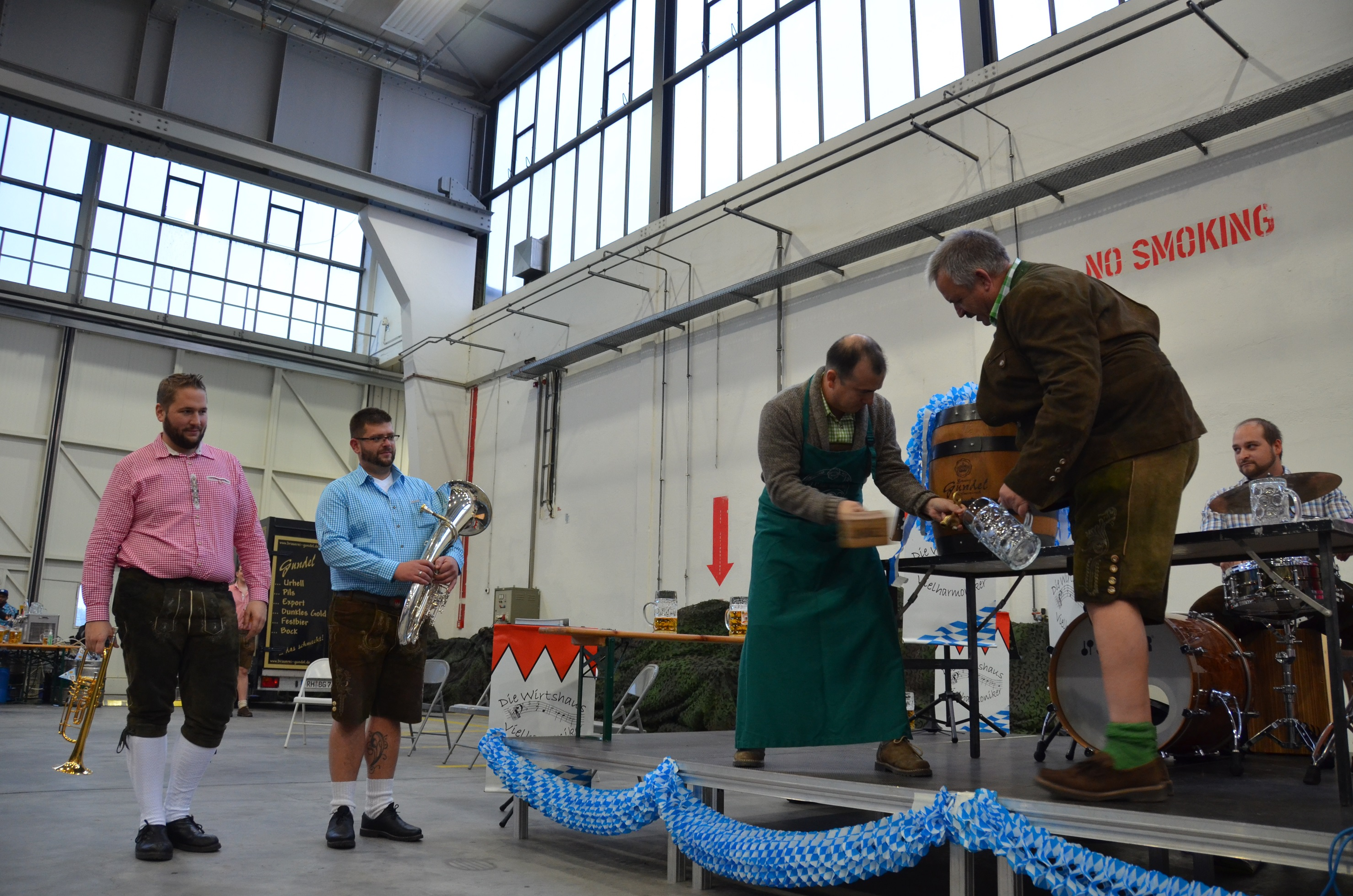 ILLESHEIM, Germany (Nov. 1, 2016) -- Lt. Col. Jason Arriaga, commander of 3rd Battalion (Assault Helicopter), 501st Aviation Regiment, Combat Aviation Brigade, 1st Armored Division, taps into the ceremonial beer barrel during 3-501st's Oktoberfest event. The battalion celebrated Oktoberfest Oct. 21 at a hangar here at Storck Barracks, where the battalion is rotationally stationed.