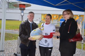 Susanna Reinhart, center, was the fastest female finisher during the Turkey Trot.
