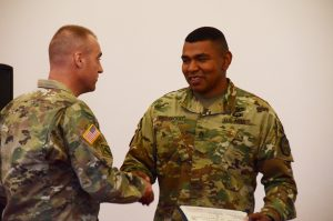 Command Sgt. Maj. Derek R. Cuvellier, left, U.S. Army Garrison Ansbach command sergeant major, thanks Staff Sgt. Lionell Red Cloud, patrol team leader with the USAG Ansbach Provost Marshal's Office, for sharing his Family history and cultural heritage with the garrison.