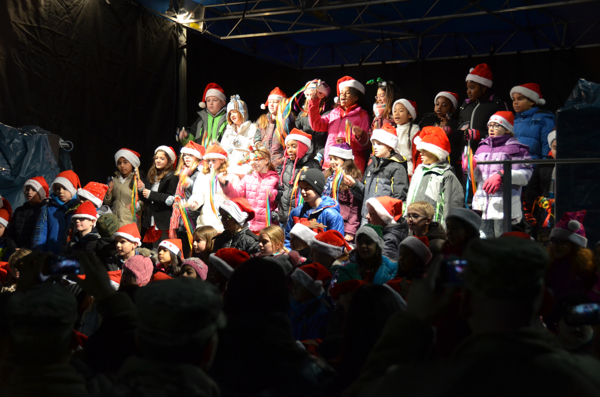 Ansbach Elementary School Choir performs during the tree-lighting portion of the USAG Ansbach Holiday Tree Lighting and Market.