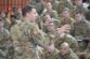 Col. Benjamin C. Jones, U.S. Army Garrison Ansbach commander, briefs Soldiers of 10th Combat Aviation Brigade after their arrival to Storck Barracks.