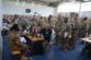 Soldiers of 10th CAB, newly arrived to USAG Ansbach, line up at service representatives for Installation Access.
