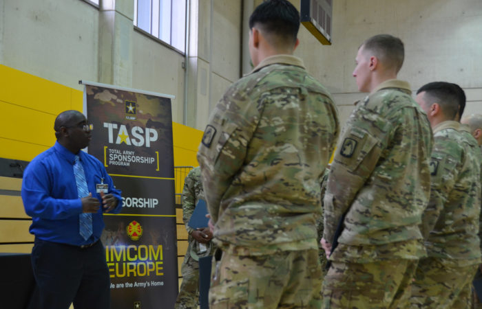 David Moore, representing Unit Sponsorship at the Total Army Sponsorship Program rodeo, talks to Soldiers about how good sponsorship can positively affect unit readiness.