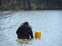 "A member of the Technische Einsatzeinheit of the Nrnberg Polizei prepares to search Soldiers Lake for a ""weapon"" during a crime scene exercise."