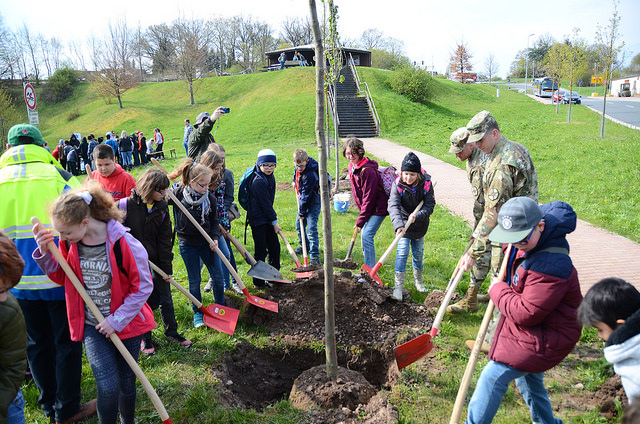 German, American students join forces at Soldiers Lake for combined Earth Day/Arbor Day event