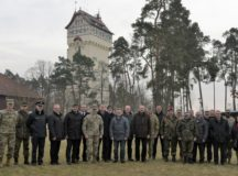 Over 35 distinguished visitors pose for a photo during a Local Leaders Day hosted by Brig. Gen. Aguto during Dynamic Front 18 at the Grafenwöhr Training Area, Mar. 5, 2018.  Dynamic Front 18 is a U.S. Army-led exercise focusing on the integration of joint fires and allied artillery interoperability at the Grafenwöhr Training Area Feb. 23 - March 10, 2018.