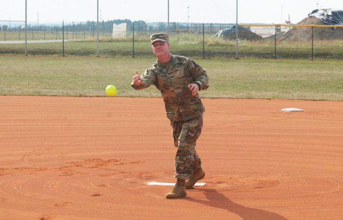 USAG Ansbach Garrison Commander Col. Steven Pierce throws the first pitch at the unit level championship final Aug. 2, 2018 (Photo by Ed Duvall)