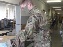 Soldiers assist post office workers at U.S. Army Garrison Ansbach