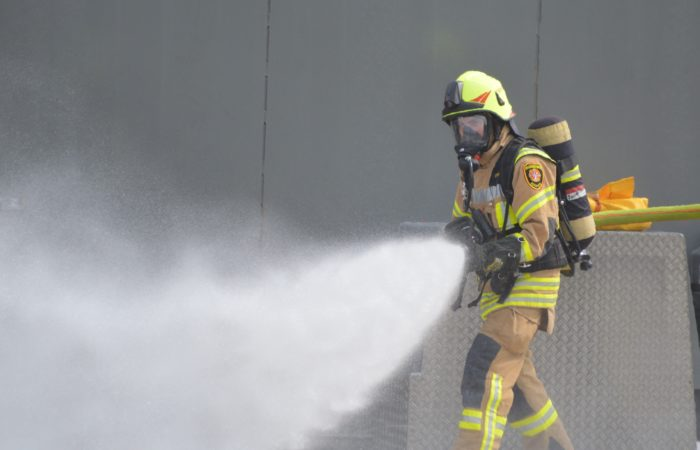 A U.S. Army Garrison Ansbach firefighter practices putting out a fire at the Regional Fire Fighters Training Center on Urlas Kaserne Sept. 24, 2020.  U.S. Army Garrison Ansbach Directorate of Emergency Services firefighters who were selected as the Installation Management Command-Europe Small Fire Department of the Year for 2020.