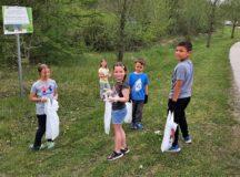 Community members, children organize mini spring clean-up